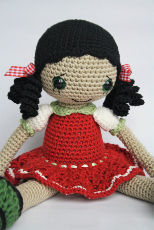 Amigurumi doll with curly hair
